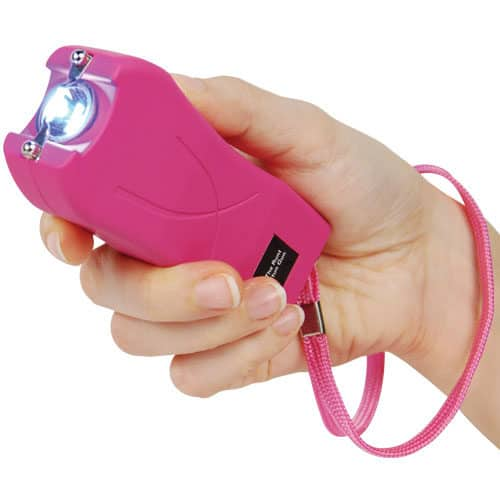 pink runt stun gun woman's hand safety strap