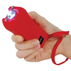 red runt stun gun woman's hand safety strap