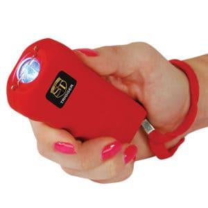 Red Trigger Stun Gun in Woman's Hand